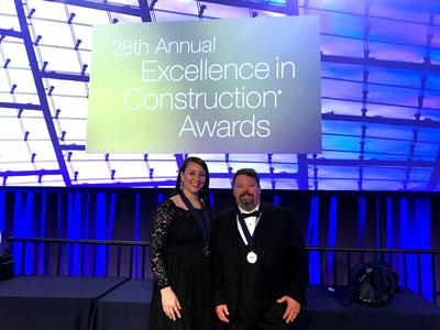 On behalf of Manhattan Construction Company, Safety Managers Trista Shomo and Scott March accepted the National Safety Pinnacle Award from the Associated Builders and Contractors (ABC) on March 21 during the 28th annual Excellence in Construction® Awards at ABC Convention 2018 in Long Beach, Calif.